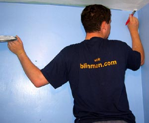 Phil painting in a blinman.com T Shirt